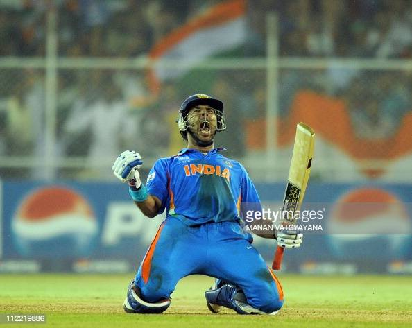Indian batsman Yuvraj Singh celebrates after beating Australia during the quarterfinal match of The ICC Cricket World Cup 2011 between India and...