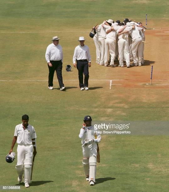 Indian batsmen Munaf Patel and Shanthakumaran Sreesanth walk off the field followed by umpires Darrell Hair and Simon Taufel as the England team form...