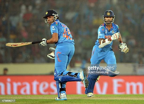 Indian batsmen Rohit Sharma and Shikhar Dhawan run between the wickets during the ICC World Twenty20 tournament cricket match between India and...