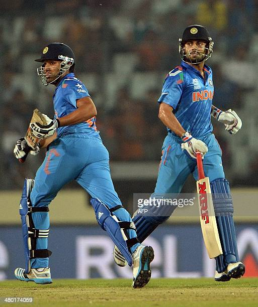 Indian batsmen Rohit Sharma and Virat Kohli run between the wickets during the ICC World Twenty20 tournament cricket match between India and West...