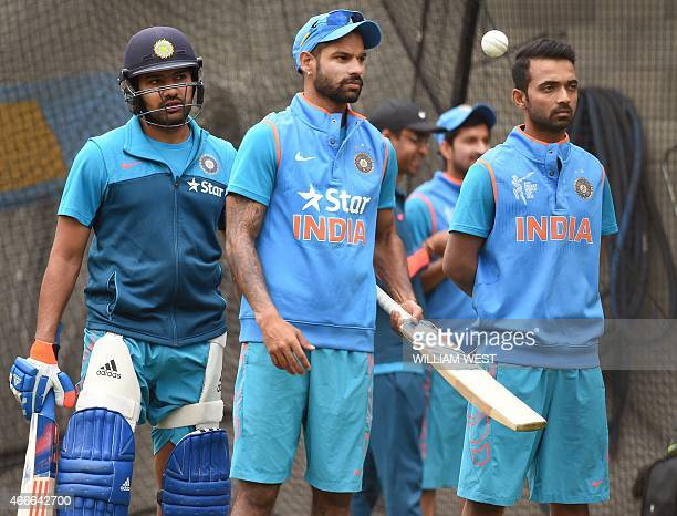 Indian batsmen Rohit Sharma Shikhar Dhawan and Ajinkya Rahane stand in the nets during a training session ahead of their 2015 Cricket World Cup...