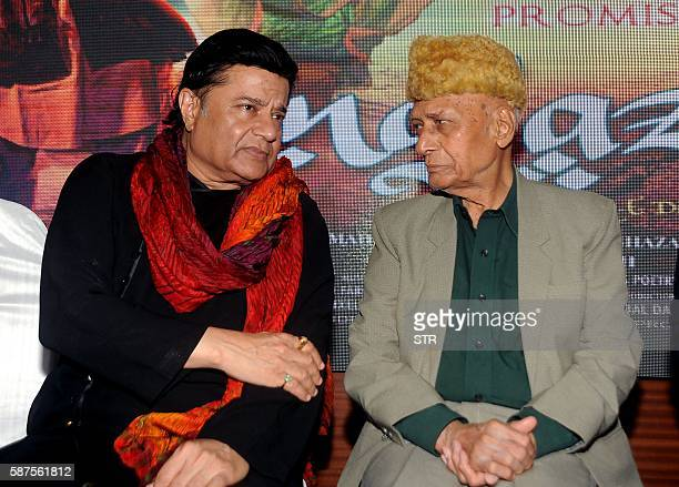 Indian Bhajan and Ghazal singer Anoop Jalota speaks with music director composer Khayyam as they attend the music launch of the forthcoming HindiUrdu...