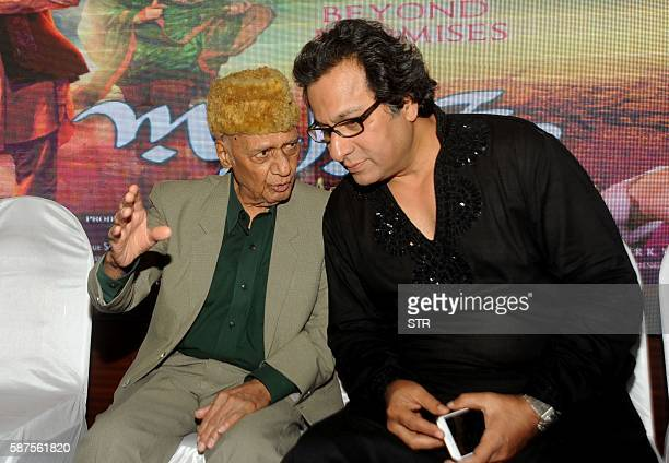 Indian Bhajan and Ghazal singer Talat Aziz speaks with music director composer Khayyam as they attend the music launch of the forthcoming HindiUrdu...
