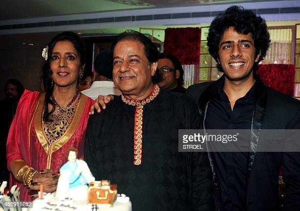 Indian bhajan samrat and ghazal singer Anup Jalota his wife Medha and his son Aryaman pose for a photograph during celebrations for his 61st birthday...