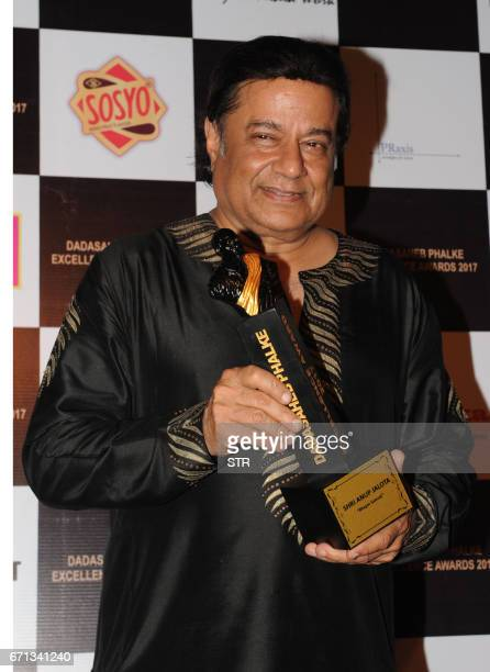 Indian Bhajan singer Anup Jalota poses as he attends the Dadasaheb Phalke Excellence Awards Ceremony 2017 in Mumbai on April 22 2017 / AFP PHOTO / STR
