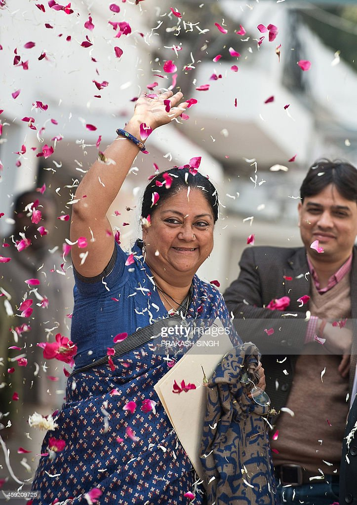 Indian Bharatiya Janata Party leader and Rajasthan Chief Minister Vasundhara Raje waves as she arrives for the BJP's Chief Ministers' conference at...