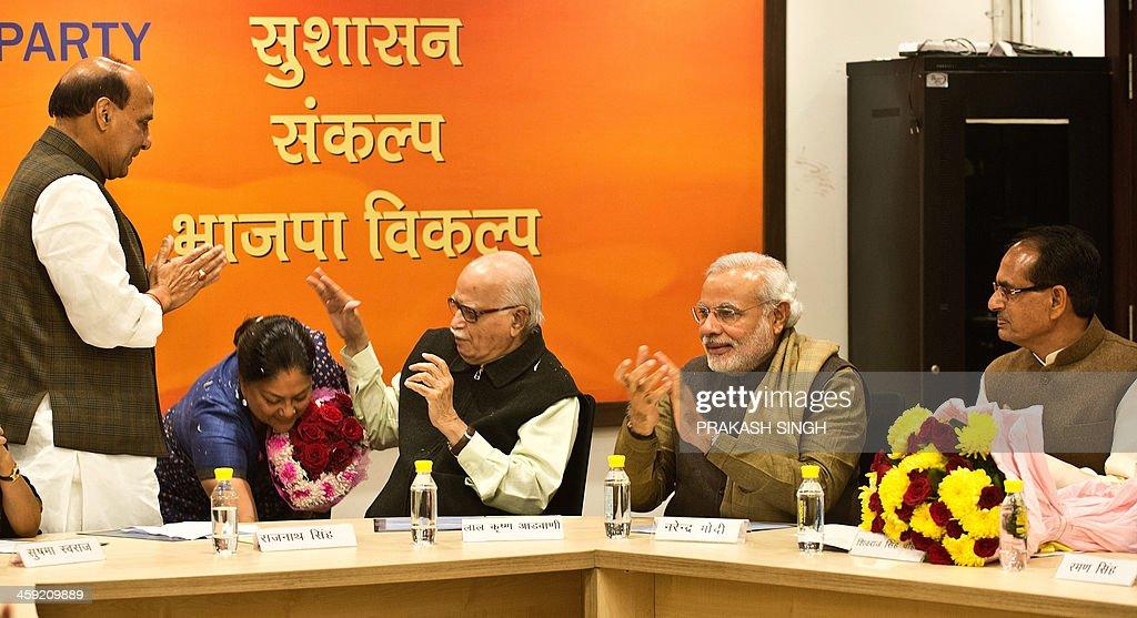 Indian Bharatiya Janata Party President Rajnath Singh Gujarat state Chief Minister Narendra Modi and Madhya Pradesh state Chief Minister Shivraj...