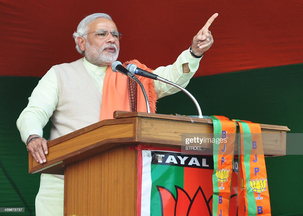 Indian Bharatiya Janata Party prime ministerial candidate and Gujarat state Chief Minister Narendra Modi addresses supporters during a party rally in...