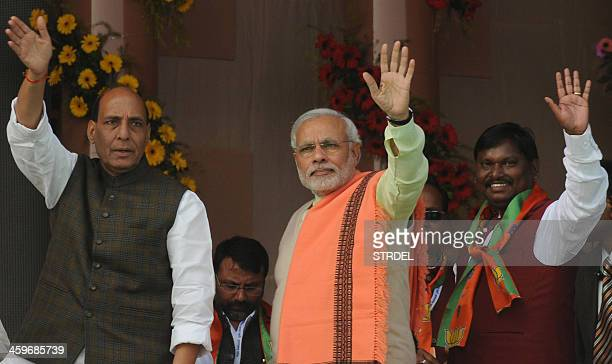 Indian Bharatiya Janata Party prime ministerial candidate and Gujarat state Chief Minister Narendra Modi together with BJP President Rajnath Singh...