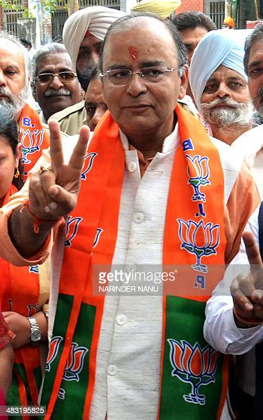 Indian Bharatiya Janata Party senior leader and candidate for Amritsar's parliamentary seat Arun Jaitley shows the victory sign as he arrives to file...