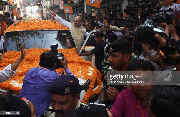 Indian Bharatiya Janta Party national president Amit Shah gestures as he arrives to meet party workers in a neighbourhood in Kolkata on April 27 2017...