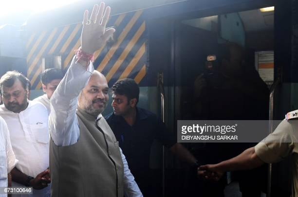 Indian Bharatiya Janta Party national president Amit Shah waves as he arrives at Sealdah railway station in Kolkata on April 26 2017 The BJP leader's...