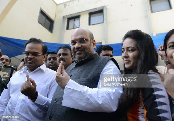 Indian Bhartiya Janta Party national president Amit Shah his son Jai and his daughterinlaw Ruchita pose after casting their votes in Ahmedabad on...
