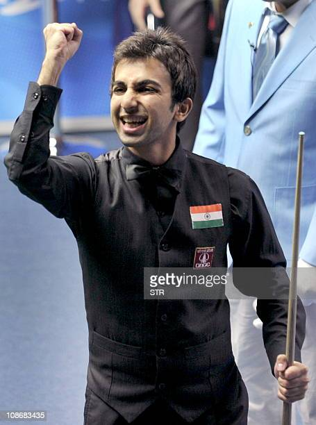 Indian billiard player Pankaj Advani reacts after winning the men's English billiards singles final at the 16th Asian Games in Guangzhou on November...