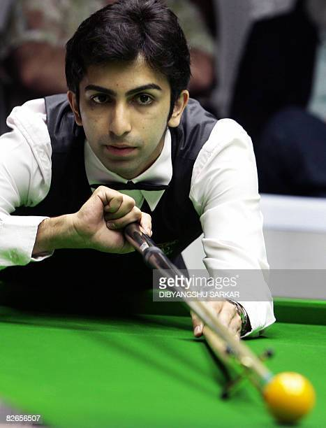 Indian billiards player Pankaj Advani plays a shot during his semifinal match in the International Billiards and Snooker Fedaration World...