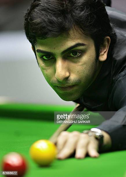 Indian billiards player Pankaj Advani plays a shot during his points final match against compatriot Geet Sethi during the International Billiards and...