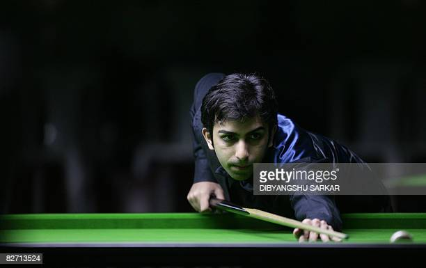 Indian billiards player Pankaj Advani plays a shot during his quater final match in the International Billiards and Snooker Fedaration World...