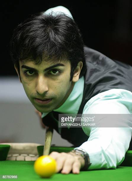 Indian billiards player Pankaj Advani plays a shot during the final match of the International Billiards and Snooker Federation World Championship in...