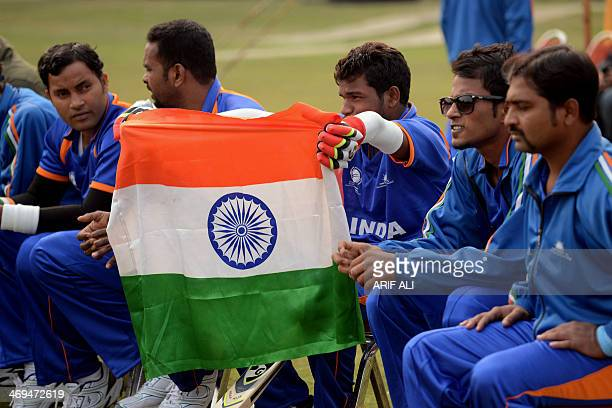 Indian blind cricketers hold the national flag at the start of a match between the Pakistan and Indian blind cricket teams at the BagheJinnah cricket...