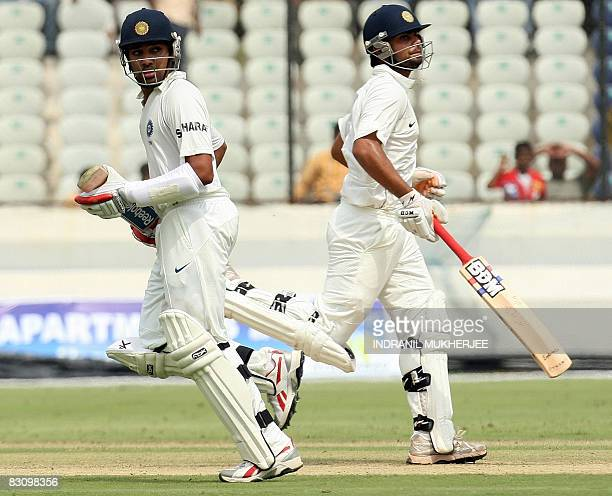 Indian Board President's XI criketers Rohit Sharma and Virat Kohli take a run during their fourday practice match against Australia in Hyderabad on...