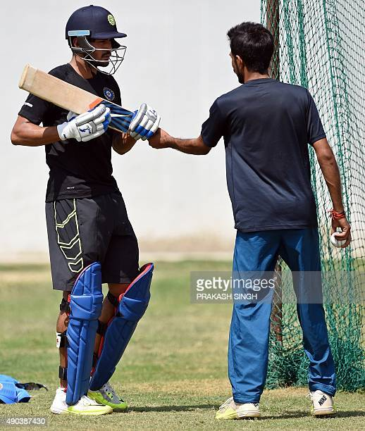 Indian Board President's XI Manish Pandey talks with Yuzvendra Chahal in nets during a training session for the practice T20 cricket match between an...