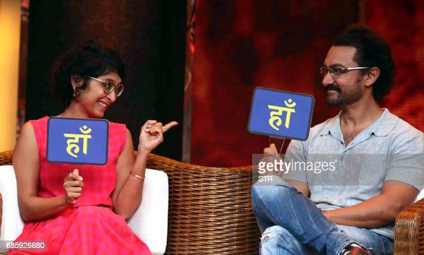 Indian Bollywood actor Aamir Khan and his wife director Kiran Rao Khan take part in the television chat show Dangal Dangal Baat Chali Hai in Mumbai...
