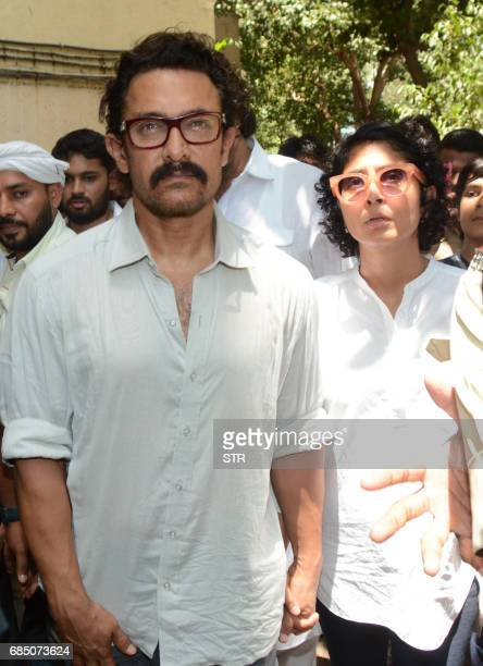 Indian Bollywood actor Aamir Khan and his wife Kiran Rao Khan arrive to attend the funeral of veteran Bollywood Hindi and Marathi film actress Reema...