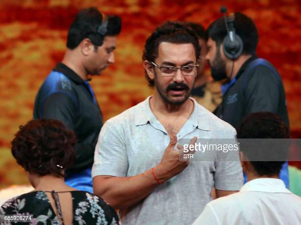Indian Bollywood actor Aamir Khan gestures as he takes part in the television chat show Dangal Dangal Baat Chali Hai in Mumbai on May 20 2017 / AFP...