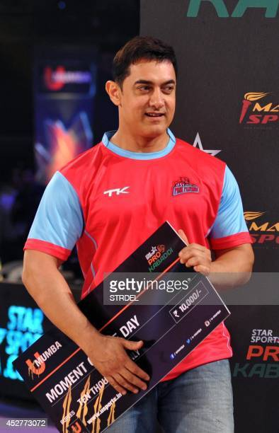 Indian Bollywood actor Aamir Khan looks on during a professional kabaddi league match in Mumbai on late July 26 2014 AFP PHOTO/STR