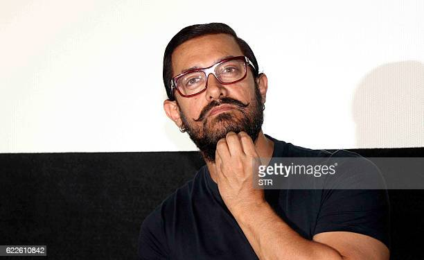 Indian Bollywood actor Aamir Khan looks on during a promotional event for the forthcoming Hindi film 'Dangal' directed by Nitesh Tiwari in Mumbai on...