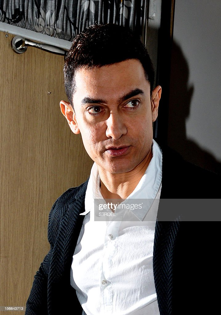 Indian Bollywood actor Aamir Khan poses as he visits a television studio in Mumbai late November 22, 2012.