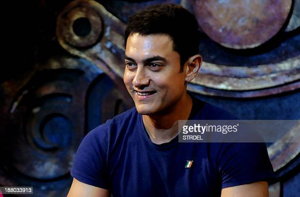 Indian Bollywood actor Aamir Khan poses during the music launch for the forthcoming Hindi film Dhoom 3 in Mumbai late November 14 2013 AFP PHOTO/STR