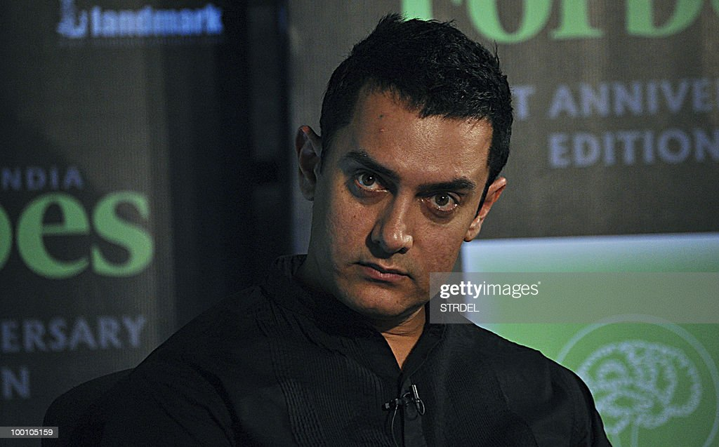 Indian Bollywood actor Aamir Khan unveils a first anniversary edition of Forbes Magazine in Mumbai late May 20, 2010.