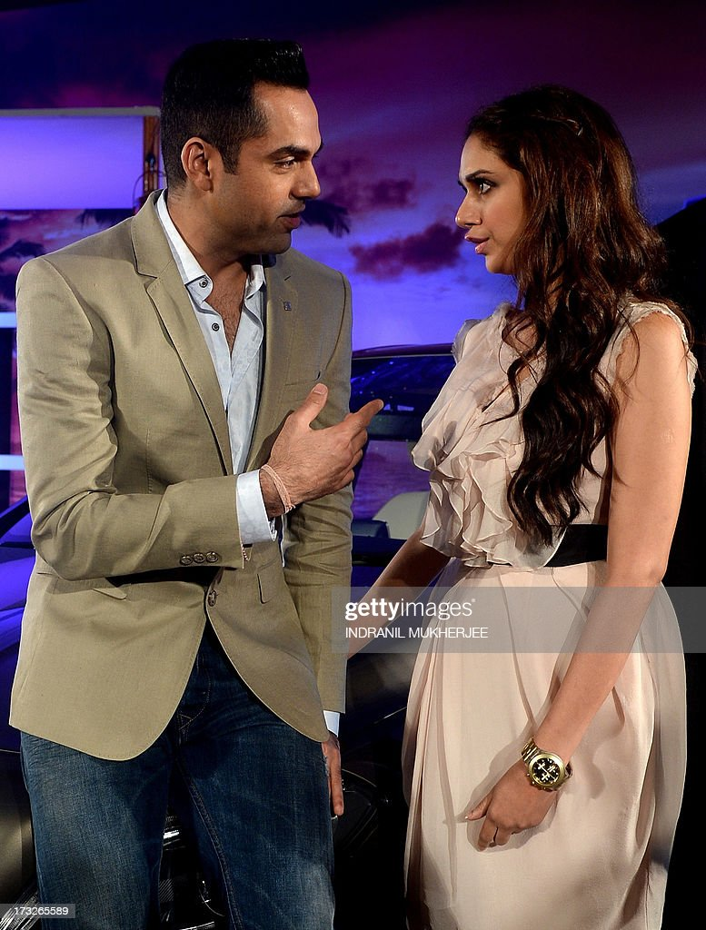 Indian Bollywood actor Abhay Deol (L) and actress Aditi Rao Hydari interact during a news conference at the launch of the new Mercedes-Benz B Class 180 CDI in Mumbai on July 11, 2013. AFP PHOTO/ INDRANIL MUKHERJEE