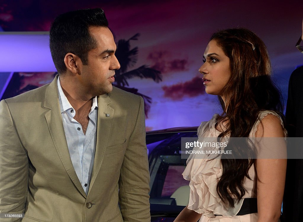 Indian Bollywood actor Abhay Deol (L) and actress Aditi Rao Hydari interact during a news conference at the launch of the new Mercedes-Benz B Class 180 CDI in Mumbai on July 11, 2013.