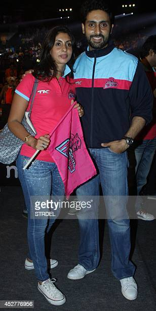Indian Bollywood actor Abhishek Bachchan and his sister Shweta Bachchan pose for a photograph during a professional kabaddi league match in Mumbai on...