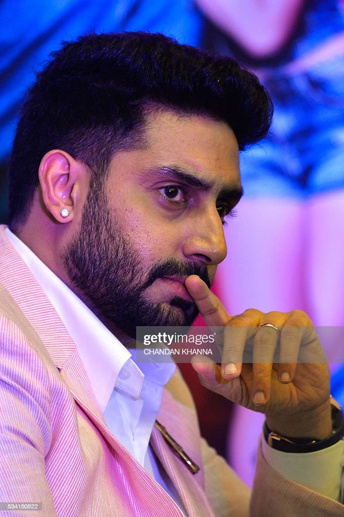 Indian Bollywood actor Abhishek Bachchan gestures during a promotional event of the forthcoming Hindi film 'Housefull 3' in New Delhi on May 25, 2016. / AFP / CHANDAN