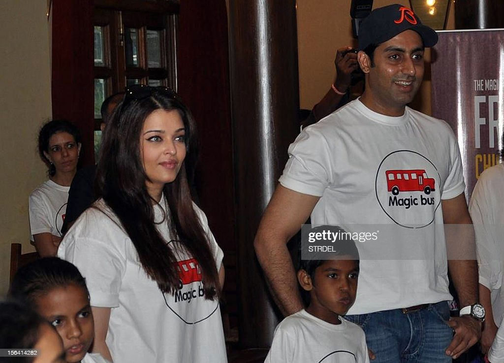 Indian Bollywood actor Abhishek Bachchan (R) poses with his wife Aishwarya Rai Bachchan (L) on the occasion of Children's Day in Mumbai late November 14, 2012.