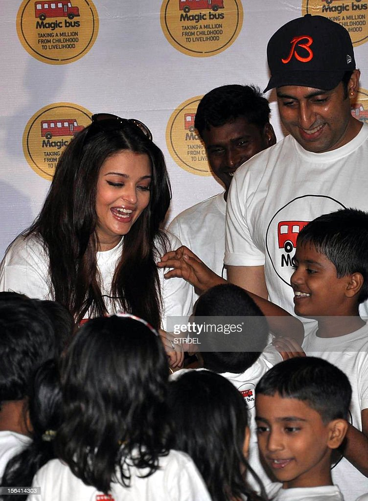 Indian Bollywood actor Abhishek Bachchan (R) poses with his wife Aishwarya Rai Bachchan on the occasion of Children's Day in Mumbai late November 14, 2012.