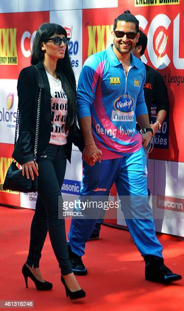 Indian Bollywood actor Aftab Shivdasani and his girlfriend Nin Dusanj arrive during the Celebrity Cricket League season five in Mumbai on January 10...