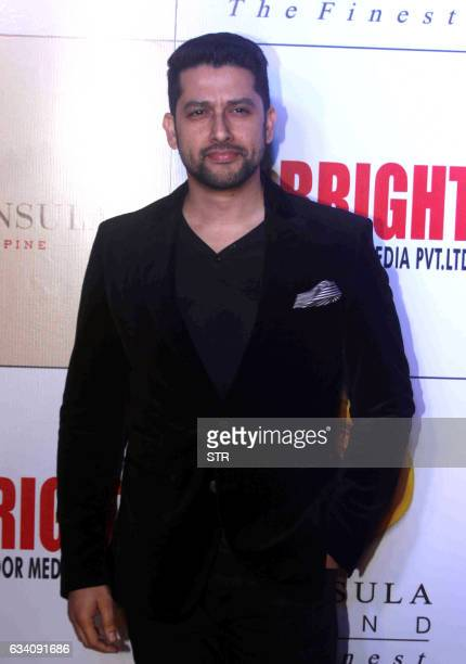Indian Bollywood actor Aftab Shivdasani poses as he attends the Bright Awards 2017ceremony in Mumbai late February 6 2017 / AFP / STR