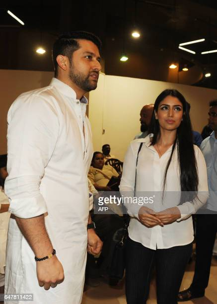 Indian Bollywood actor Aftab Shivdasani walks with his wife Nin Dusanj as they attend a prayer meeting for Veerappa Shetty the father of actor Suniel...