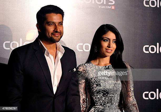 Indian Bollywood actor Aftab Shivdasani with his fiance Nin Dusanj attend the Colors IAA Awards and after party in Mumbai on March 1 2014 AFP...