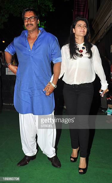Indian Bollywood actor Ajay Devgan with his wife Kajol during the inauguration of a furniture showroom by actors Sunil and Mana Shetty in Mumbai on...