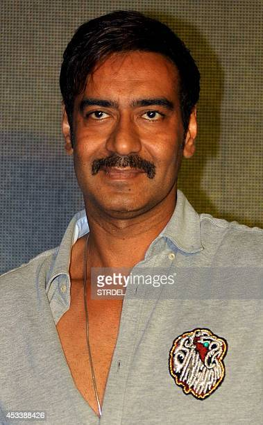 Indian Bollywood actor Ajay Devgn poses for a photograph during a promotional event for the forthcoming Hindi film 'Singham Returns' directed by...