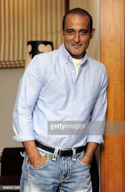Indian Bollywood actor Akshaye Khanna attends a promotional event for the upcoming thriller Hindi film Mom in Mumbai on June 20 2017 / AFP PHOTO /
