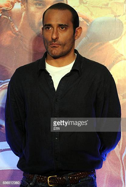 Indian Bollywood actor Akshaye Khanna poses for a photograph during a promotional event for the forthcoming Hindi film 'Dishoom' directed by Rohit...