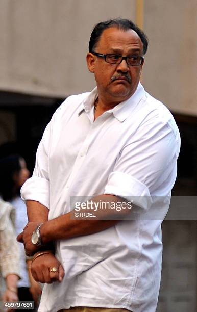 Indian Bollywood actor Alok Nath attends a memorial prayer for late Bollywood actor Farooq Sheikh in Mumbai on December 30 2013 Sheikh died of a...
