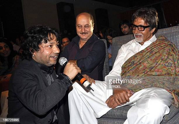 "Indian Bollywood actor Amitabh Bachchan and Anupam Kher listen to Indian singer Kailash Kher during the release of his new album ""Kailasha Rangeele""..."