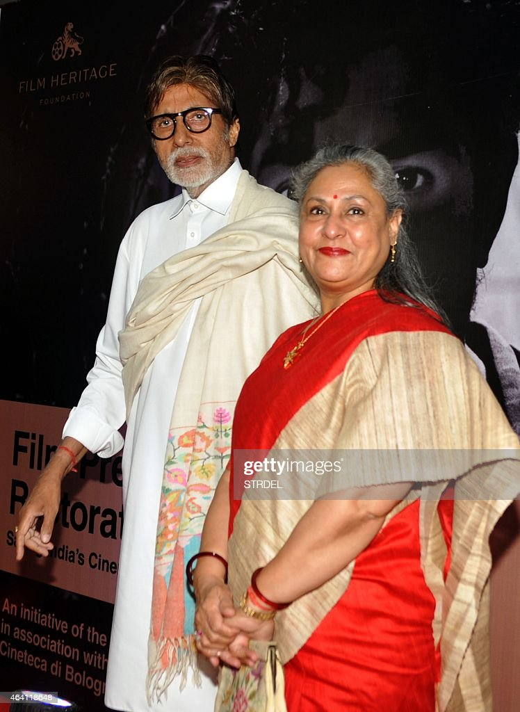 Indian Bollywood actor <a gi-track='captionPersonalityLinkClicked' href=/galleries/search?phrase=Amitabh+Bachchan&family=editorial&specificpeople=220394 ng-click='$event.stopPropagation()'>Amitabh Bachchan</a> (L) and his wife <a gi-track='captionPersonalityLinkClicked' href=/galleries/search?phrase=Jaya+Bachchan&family=editorial&specificpeople=1026829 ng-click='$event.stopPropagation()'>Jaya Bachchan</a> arrive at the launch of Film Preservation and Restoration School India a week long education workshop - at an opening ceremony in Mumbai on February 22, 2015. AFP PHOTO/STR